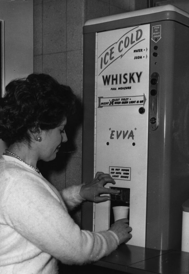 The best for last: the whiskey vending machine. | 15 Weird Vending Machines Of The '60s