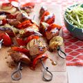 Beer Brat Skewers with Spicy Slaw - Bite-size bratwurst slices alternate with veggies in this kebab which is basted in a beer—brown sugar sauce.
