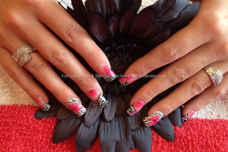 Full set of acrylic with black and white zebra print and pink flower as nail art