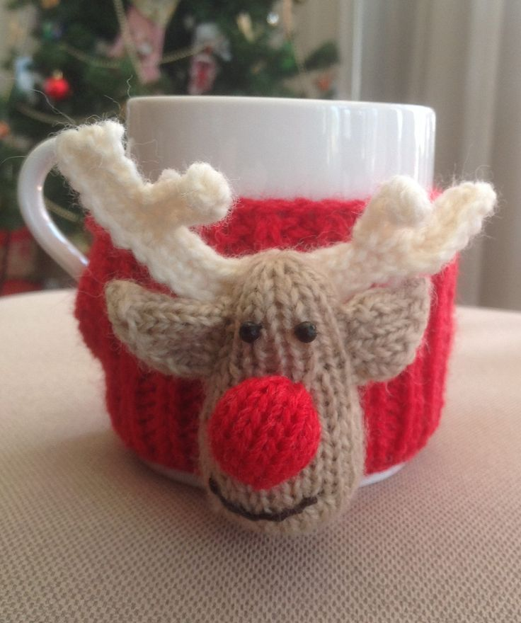 Free Knitting Pattern for Reindeer Cup Cosy - Adorable mug cozy with Rudolph face. Small amount of crochet for antlers but you could probably figure out a knit adaptation. Designed by Jenny Stacey. Pictured project by karne71