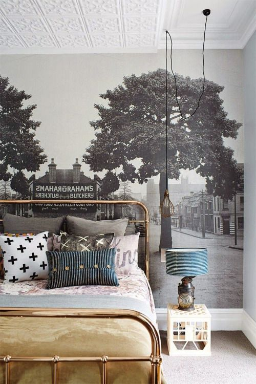 Photo as wallpaper. Cool, eclectic room with pillows and brass bed frame