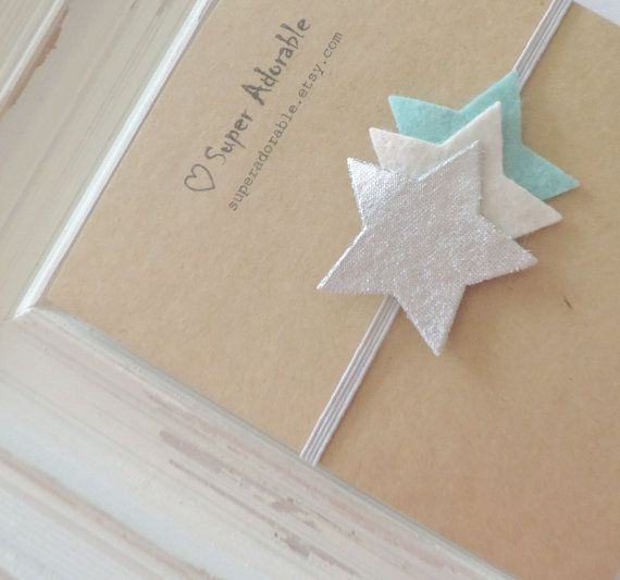 Adorable little stars headband. They come attached to a soft and comfortable light grey skinny elastic headband.    Backed with felt for your