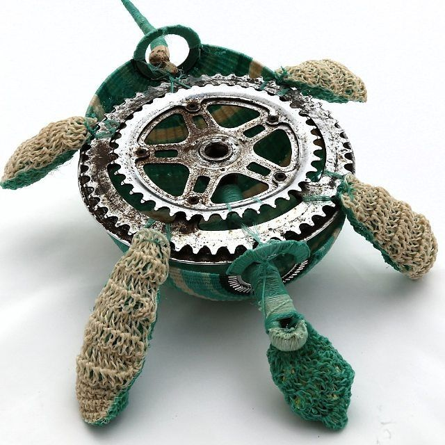 The secret underbelly of my ghostnet turtle - a recycled bicycle crank!