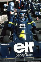 HEUSDEN-ZOLDER, BELGIUM: Patrick Depailler waits to drive the six-wheel Tyrrell P34 4/Ford Cosworth DFV during practice for the Grand Prix of Belgium on May 16, 1976 at the Circuit Zolder near Heusden-Zolder, Belgium.