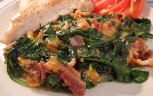 With delicious and decadent side dish recipes like this one, why would you not want to try out a low carb diet? Kent Altena's Cheesy Bacon Spinach recipe takes the flavor of Popeye's favorite vegetable to a whole new level with the addition of sharp cheddar cheese and crisp bacon. You only need three ingredients total to concoct this low carb vegetable side dish. Pair with a piece of grilled chicken or pork for the ultimate low carb meal.