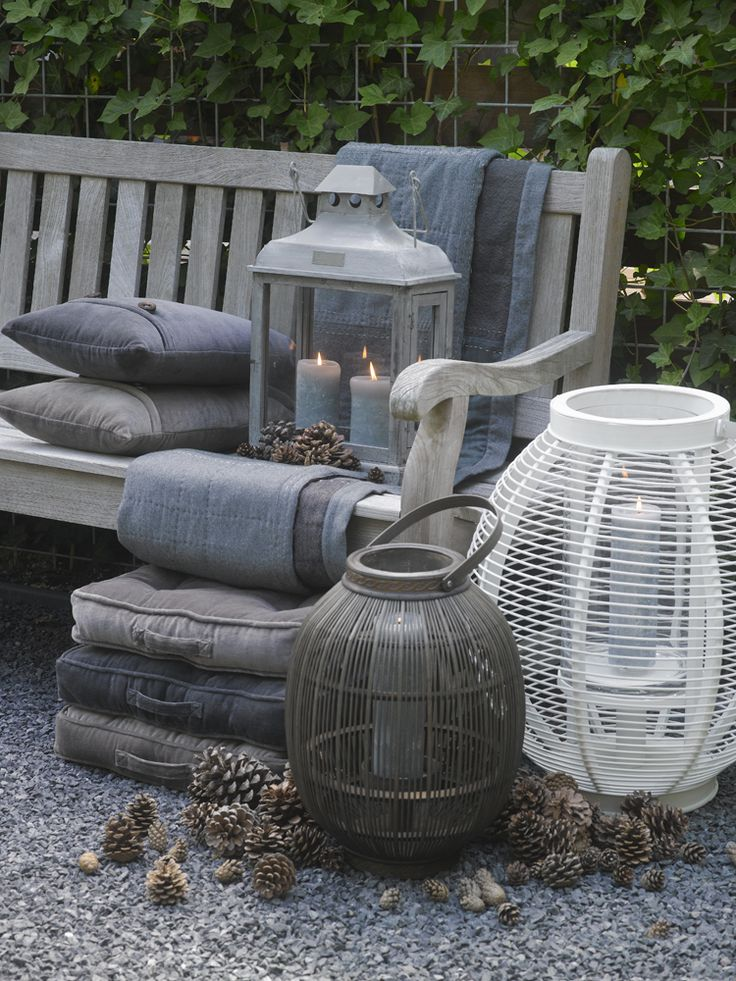 lanterns, cushions and throws in shades of grey, white and taupe