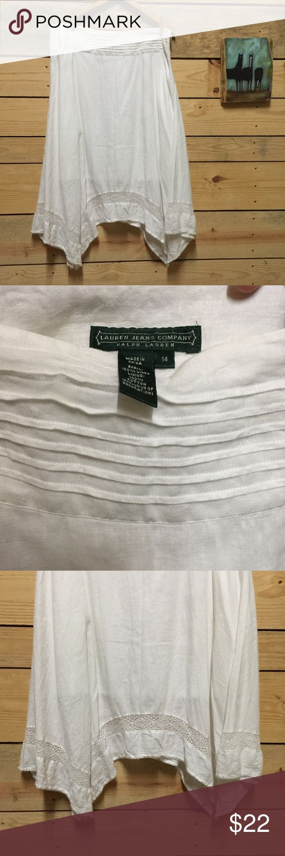 Lauren jeans Co white linen peasant  skirt  sz 14 Lauren Jeans Co.  by Ralph Lauren.   Skirt is classic white linen with handkerchief hemline.   This skirt is lined (I tried to show this in last pic). Beautiful detail at waistband and at hemline.   Hippie gypsy peasant style.  Would go beautifully with denim /turquoise and cowboy boots. Size 14. Lauren Jeans Co Skirts