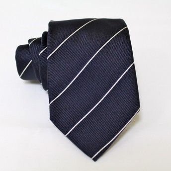 Jacquard tie, 100% silk, blue with classic white lines. Ideal for less formal occasions but also special occasions. Pattern and color of this elegant tie can fit with any outfit.