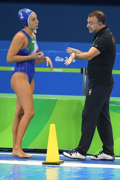 Fabio Conti, coach of Italy, talks to Chiara Tabani #2 of Italy during the Women's Water Polo Gold Medal match between the United States and Italy on Day 14 of the Rio 2016 Olympic Games at the Olympic Aquatics Stadium on August 19, 2016 in Rio de Janeiro, Brazil.