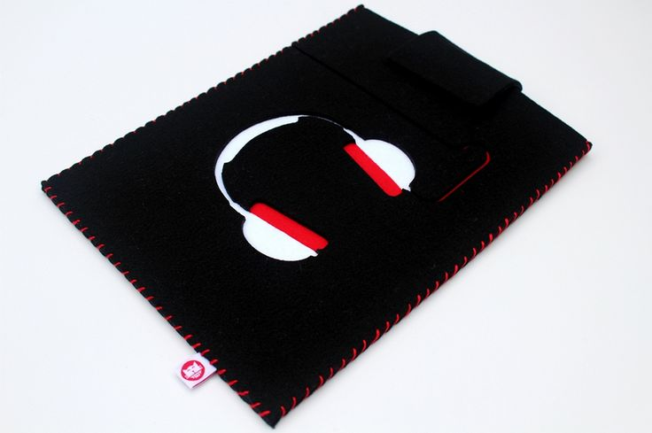 Black laptop case decorated with the picture of white and red headphones.