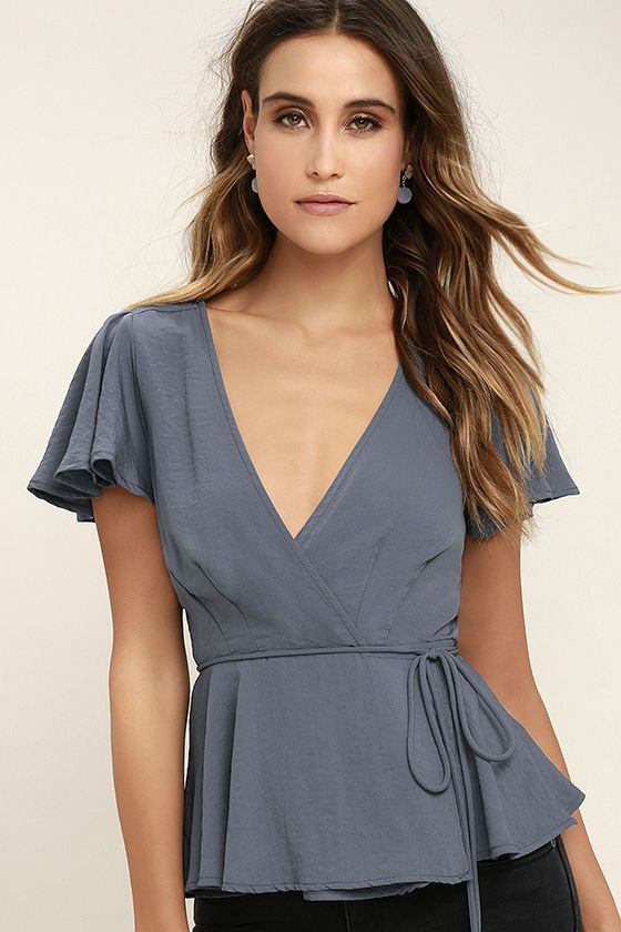 Even old-fashioned filles are falling for the chic, updated style of the Modern Gal Slate Blue Wrap Top! This woven poly wrap top has a darted bodice, plunging neckline, and fluttering short sleeves. Waist tie allows a custom fit above a ruffled hem.