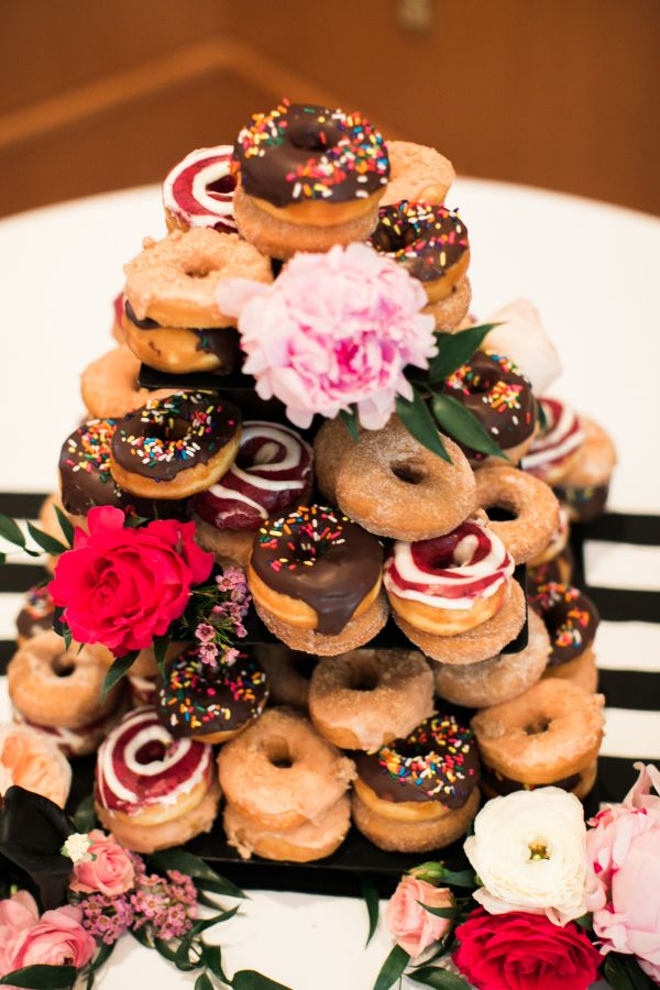 You can never have too many donuts: http://www.stylemepretty.com/2017/04/07/brunch-wedding-donut-tower/ Photography: Carolyn Marie - http://carolynmariephoto.com/