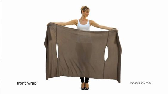 Watch video guide on how to wear The Bina™ front wrap. Create many unique looks from just one item. The Bina™ can also be worn as a scarf, cardigan, poncho, ...