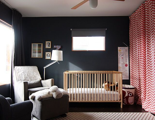 We love the simple and chic design of this dark gray and red nursery. #nursery