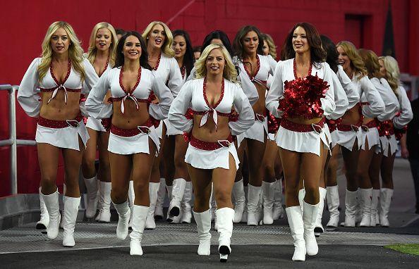 GLENDALE, AZ - SEPTEMBER 11:  The Arizona Cardinals cheerleaders take the field…