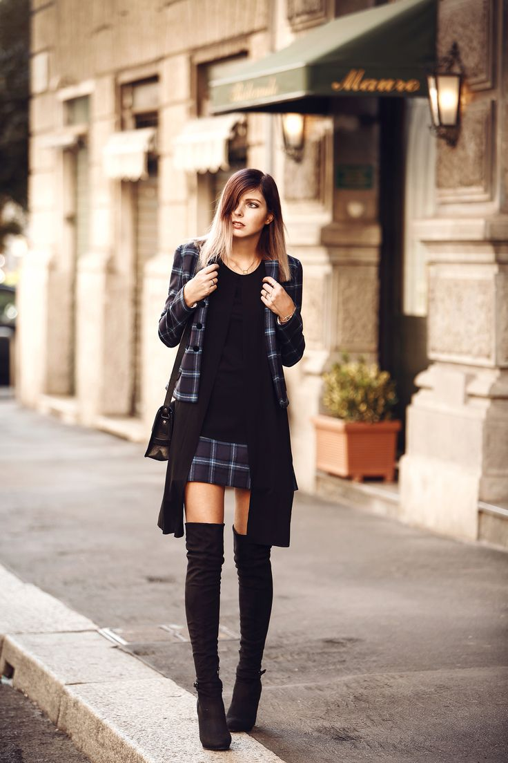 This matching tartan jacket and skirt combination from Fay is the perfect match for Jana Wind's boots. Jacket/Skirt: Fay, Top: COS, Boots: Even & Odd via Zalando.