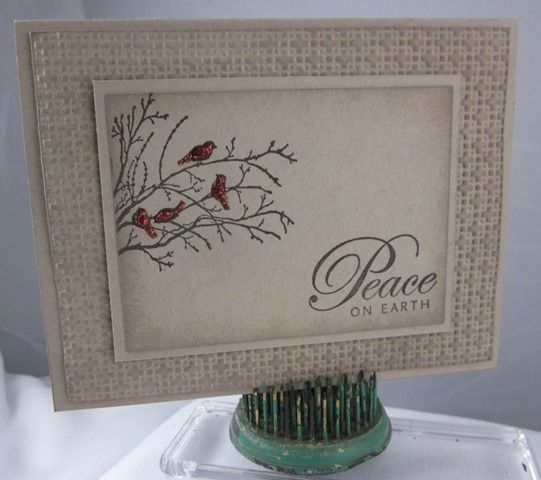 "By Carol Payne. Four layers of Crumb Cake cardstock. Main image panel sponged at edges, stamp from ""Serene Silhouettes"" by Stampin' Up. One panel dry embossed in Stampin' Up ""Square Lattice"" embossing folder then sponged. Birds highlighted with Cherry Cobbler Sazzling Details. More info on her website."