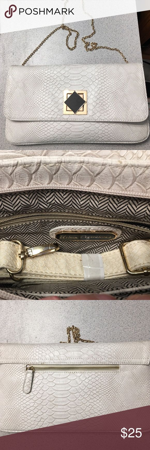 Cream clutch/crossbody bag. Large cream crossbody or clutch bag with gold chain made by urban expressions. Great condition! Urban Expressions Bags Crossbody Bags