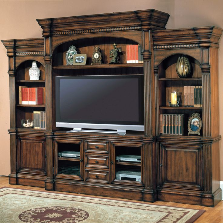 "Style for built-ins in Keeping Room - Center height taller, arched inside sections, shelf above tv, and mix of shelves, cabinets, & drawers.  Like the detail accents on top and between panels - back of shelves paneled wood. 10' l x 8' h x 23"" d"
