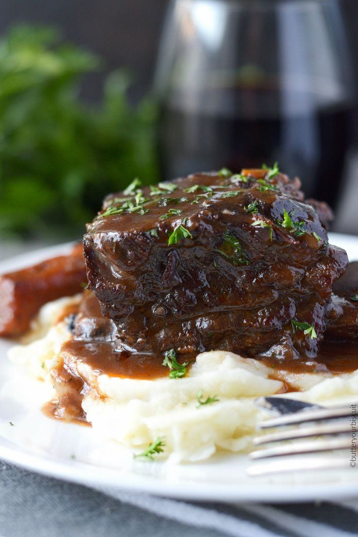 These Beef Short Ribs are braised low and slow in red wine. Fall of the bone tender and loaded with rich flavor. They are even more delicious the next day!