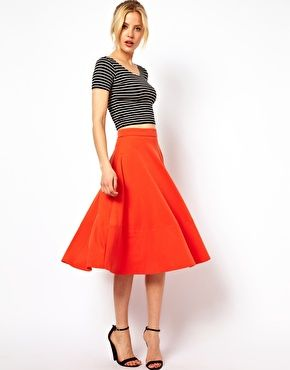 In love with this red ASOS Midi Skirt In Ponte paired with the black & white crop top. #ChicandFlirty