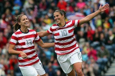 Alex Morgan and Carli Lloyd vs. Colombia, July 28, 2012. (Stanley Chou/Getty Images)