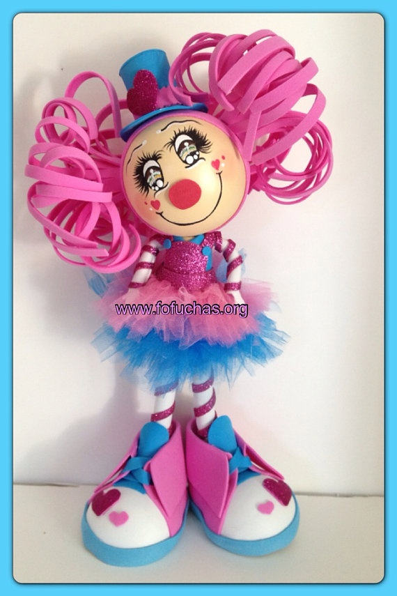 Clown Fofucha Centerpiece on Etsy, $32.00 Are you having a circus/clown theme party? Check out this lovely handmade doll.  She is made using foam sheets. Measures approx 12 inches and weight is 8oz Need more than one? Just message me and I can make as many as you need.  I can add 2 flowers just as picture above for an extra $5 Price is for doll only. Message me if you have any questions see more of my work facebook.com/fofuchashandmadedolls #Clowns #Fofuchas #Circus