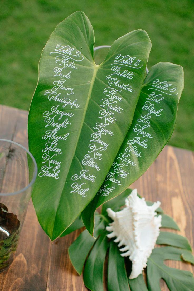 Seating chart, tropical plants, Hawaii wedding, conch shell // Chris J. Evans Photography