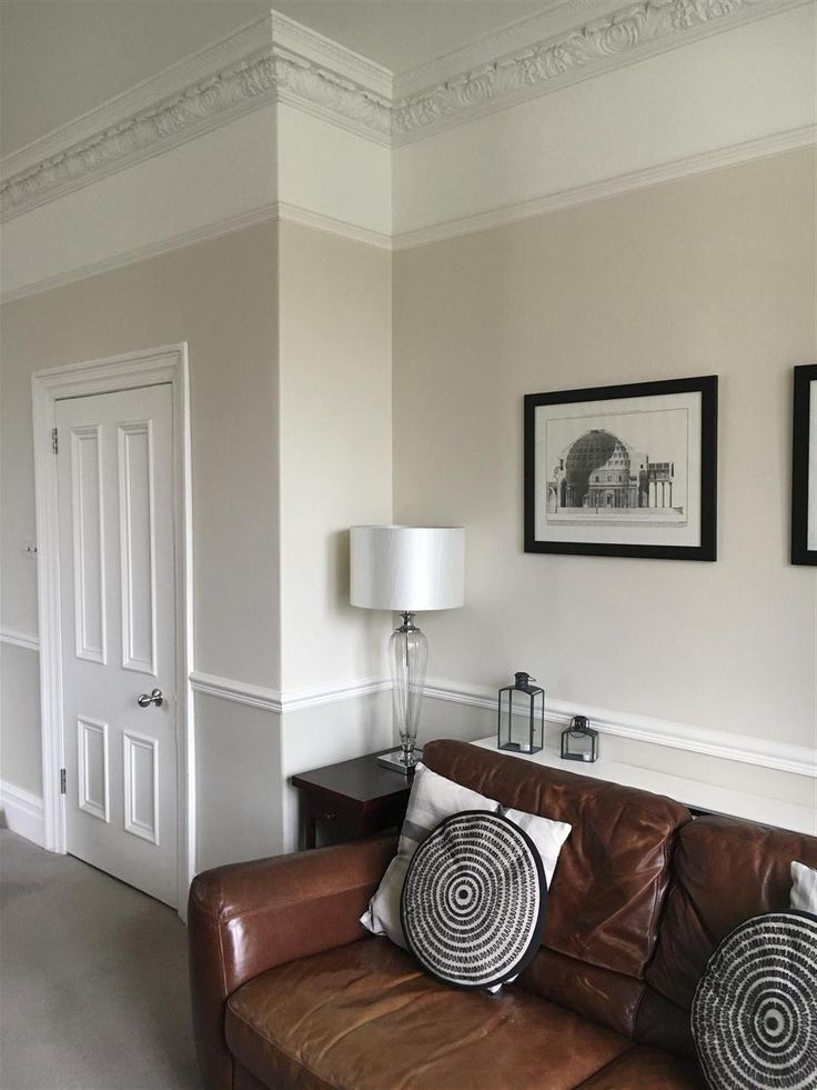 Living Room Painted In Shaded White Under Dado Slipper