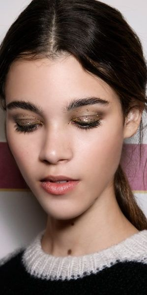 Who said glitter was just a middle-school staple? Backstage at Tommy Hilfiger, a dose of sparkle never looked more sophisticated.