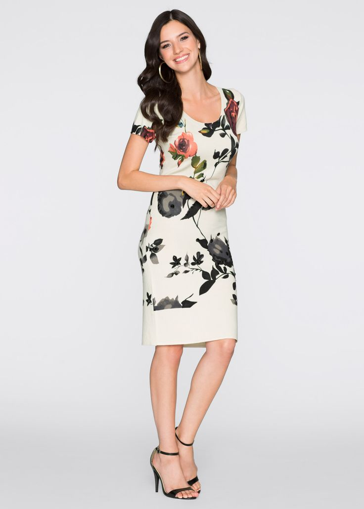 Şimdi inceleyin:Çiçek baskılı, bele oturan, ön parçası taşlarla süslü, yuvarlak yakalı ve kısa kollu elbise.