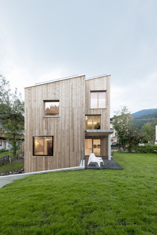 Elongated Wooden Box House Seamlessly Integrated into the Landscape in Austria