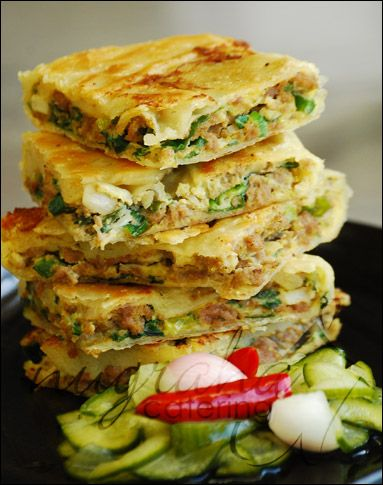 Martabak telur (egg with ground mutton or beef and green onion wrapped in similar to spring rolls wrapper and fried)