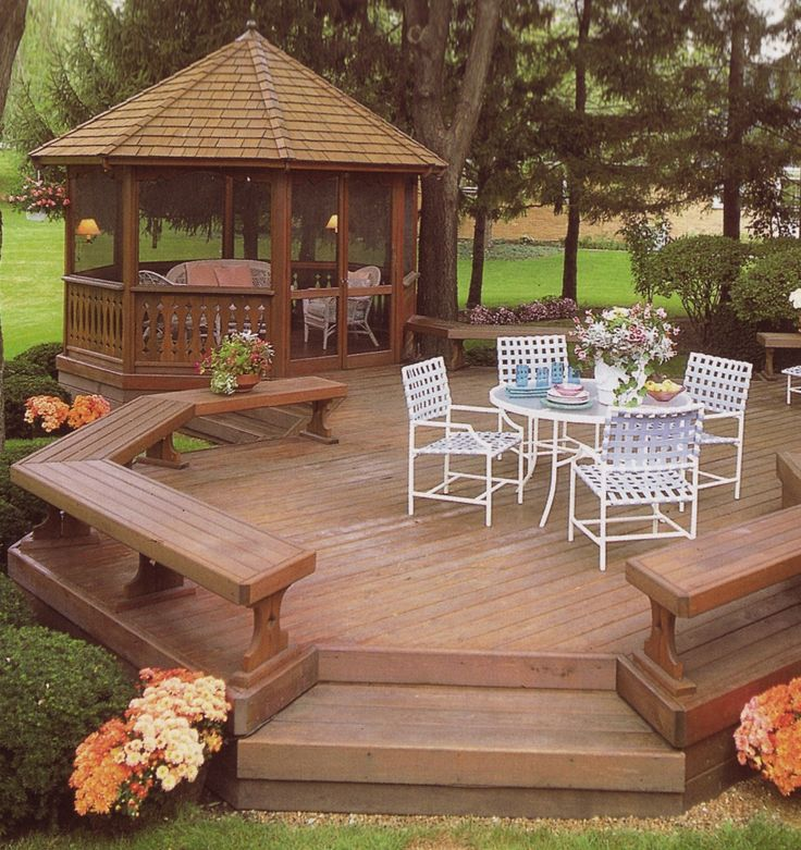Open, freestanding deck with bench seating plus a screened gazebo with screen doors to escape to when the mosquitoes come out.