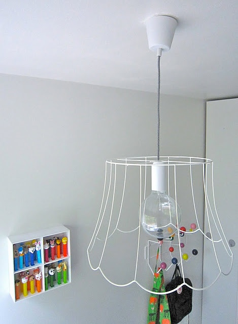Diy.Take cloth off of old lamp shade, use wire. Love it!