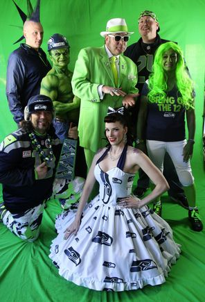 "Tim ""Seahulk"" Froemke (back row, second from left), is surrounded by other Seahawk fans who had gathered at a home in Bellevue to watch a ..."