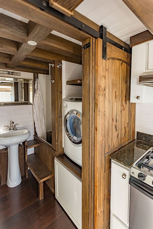 love the raised washer next to the japanese soaking tub and the barn door sliding right - Tiny House Washer Dryer
