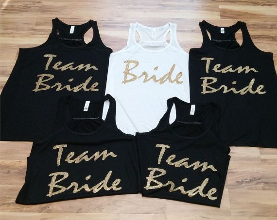 Bachelorette Party Shirts, bride shirts, team bride tanks, bachelorette shirt, bridesmaid tank, brides team, bridesmaid shirts, bride tank  These listing is for a set of flowy tank tops, with your personalized saying. Beautiful glitter print bachelorette tank tops. Our flowy tank tops run S-2XL great for petite or plus size women. Since all items are hand made and made to order , please ask us about sizing before placing your order !!  Color print will be shown as picture unless you convo…
