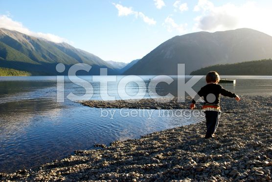 Child plays in Lake at Sunset royalty-free stock photo