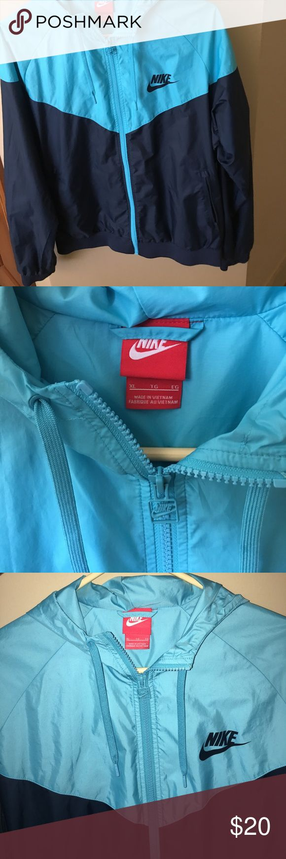 Nike Zip-Up rain jacket Nike XL zip-up jacket. Hardly ever worn. Comes from a smoke free and pet free home! Fits a little smaller than a normal XL Nike Jackets & Coats