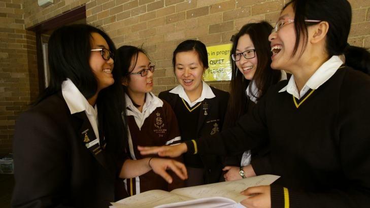 Relieved: Sydney Girls' HSC students Vicki Zhong,  Jessica Nguyen, Alisa Zheng, Vivian Tang and Mary (Zhou) Chen relax after their maths exam.