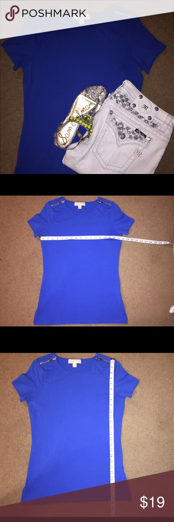 Michael Kors cobalt blue tee size M Very comfortable great fit. Both zippers on the shoulders still work and metal is silver. Slightly faded from being worn and washed. No stains, pulls,or fraying. Michael Kors Tops Tees - Short Sleeve