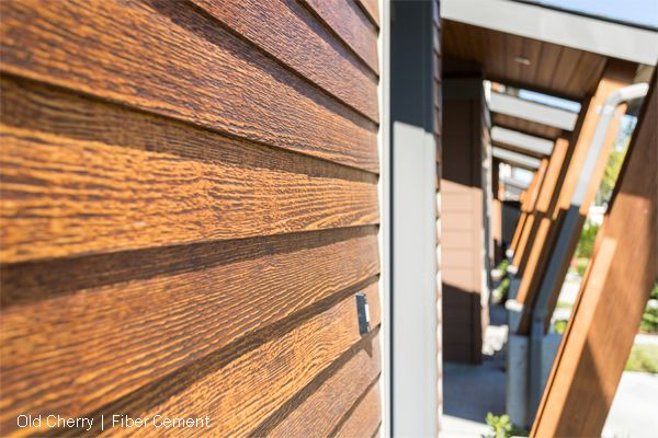 Woodtone rusticseries fiber cement siding by woodtone for Exterior siding that looks like wood