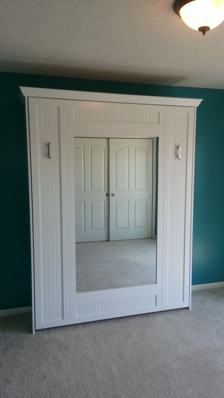 Our customer from Chicago, Illinois decided to go with something different. This is the BedderWay Vertical Queen Mirror Face Murphy bed with maple beadboard painted white with brushed chrome livello handles. To see more styles please visit www.bedderway.com