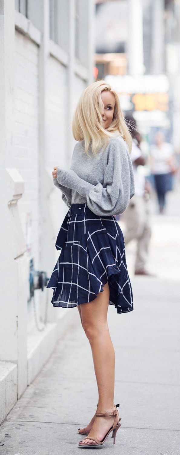 Twirly and flirty in a plaid mini skirt.