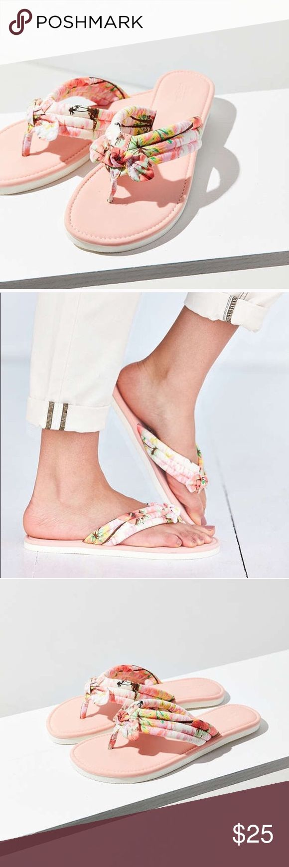 Tropical print thong Give your look a touch of paradise with this printed thong sandal, UO. Tropical printed sandal with thick seamed straps accented with a bow at toes. Laid on a flat, cushy EVA sole.  Content + Care - Cotton, polyester, EVA - Wipe clean Urban Outfitters Shoes Sandals