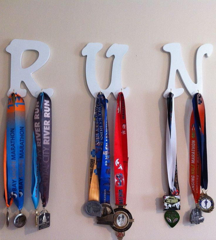 RUN medal hanger I made to display all of my race medals! Spray painted letters and hooks! Super simple!