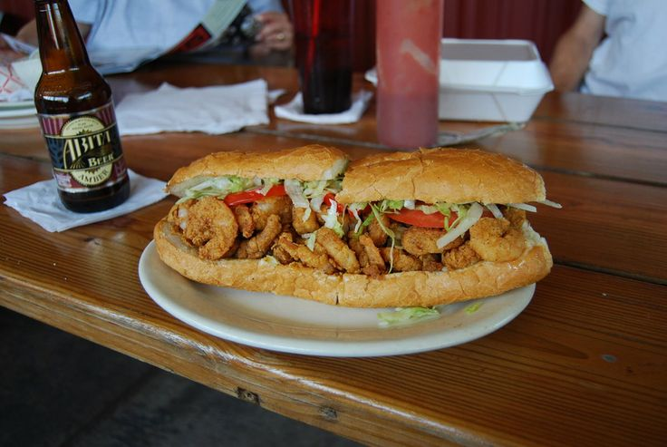 If in LOUISIANA: Sit down with a po'boy sandwich stuffed with fried catfish, oysters, soft-shell crab, or even alligator.