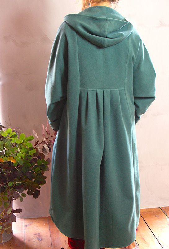 Back view of New Hooded Coat, soft green felted wool, £395.