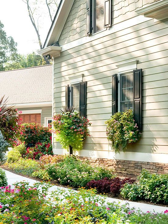 Amp up curb appeal with blossoming window boxes! More quick and easy exterior fixes: http://www.bhg.com/home-improvement/exteriors/curb-appeal/curb-appeal-tips/?socsrc=bhgpin031113windowbox=6
